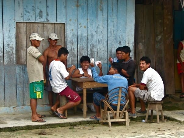 Guys Playing Cards in the Shamans' Village
